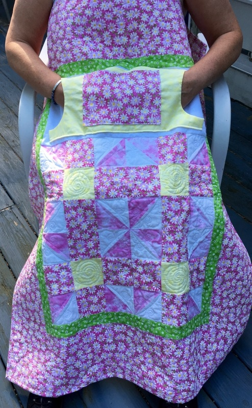 Pink Daisy Lovie Lap Quilt with Pockets from http://www.HomeSewnByCarolyn.com