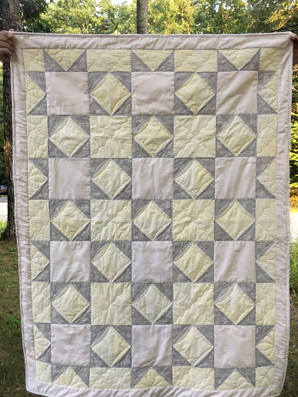 Tan, grey and yellow quilt with Minky backing from http://www.HomeSewnByCarolyn.com